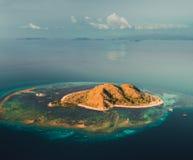 Island among the ocean. Komodo. Aerial drone shot. stock photography