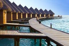 Island in ocean, Maldives  Maldives.   Villa on pi Royalty Free Stock Photography