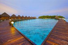 Island in ocean, Maldives. Night. Stock Images
