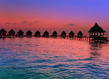 Island in ocean, Maldives.  Sunset. Stock Images