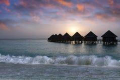 Island in ocean, Maldives.  Sunset. Stock Image