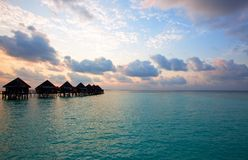 Island in ocean, Maldives . Villa on piles on wate Stock Image
