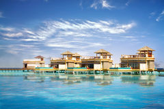 Island in ocean, overwater villa Royalty Free Stock Images