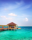 Island in ocean, overwater villa. Maldive Royalty Free Stock Photo