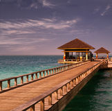 Island in ocean, overwater villa. Maldive Royalty Free Stock Photography
