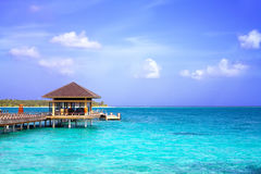 Island in ocean, overwater villa. Maldive Royalty Free Stock Photos