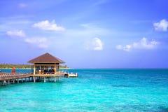 Island in ocean, overwater villa. Maldive Royalty Free Stock Photos