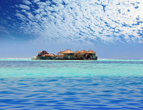 Island in ocean, overwater villas Royalty Free Stock Image