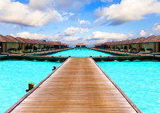 Island in ocean,overwater villas.Tropical landscap. Island in ocean,overwater villas.Landscape in a sunny day Royalty Free Stock Photo