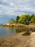 Island off Coastal Maine in Casco Bay with a Rocky Beach Stock Images