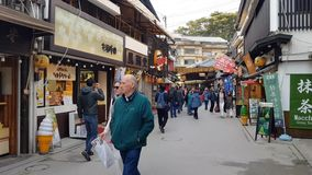 People walking in the market of Miyajima island, Japan. The island is one of the most scenic sights of Japan and hosts numerous of temples stock video