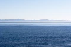 Island over ocean Stock Image