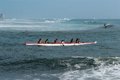 Island Paddlers. Paddling out the ocean royalty free stock photography