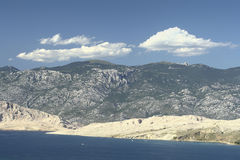 Island Pag-Croatia. This photo introduces island Pag ,mountains,and mediterranean sea.(Croatia Europa Royalty Free Stock Images