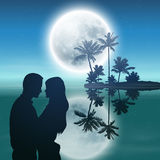 Island with palm trees, full moon and couple. Stock Photos