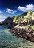 The island with palm trees and traditional tropical hut, , cross-process. Island with palm trees and traditional tropical hut, , cross-process Royalty Free Stock Image
