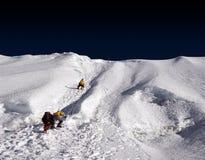 Island Peak Ridge - Nepal. Mountaineers ascending the upper ridge to reach summit of Island Peak, Nepal stock images