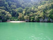 An island in Phuket, Thailand - Secluded Beaches. Surrounded by beautiful sea green water and dense plantation all around, this place an offers exotic place or Stock Images