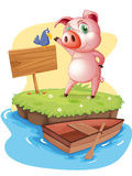 An island with a pig and a bird near an empty signage Royalty Free Stock Images
