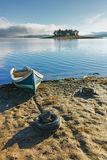 Island with pines and boat in Batak Reservoir, Bulgaria Royalty Free Stock Photo