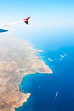 Island from the plane window. Beautiful view of island Cyprus from the plane. Mediterranean sea, Konnos Bay royalty free stock image