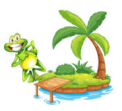 An island with a playful and smiling frog Stock Image