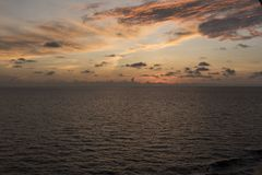 Sunset in the Caribbean from Island Princess. The Caribbean is a region of The Americas that consists of the Caribbean Sea, its islands and the surrounding stock photo