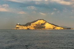 Island Procida in the gulf of Naples Italy at sunrise stock image