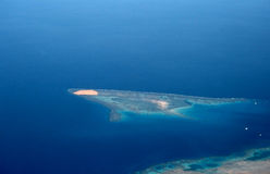 Island in the Red sea(view from plane). An island is in the Red sea Royalty Free Stock Images