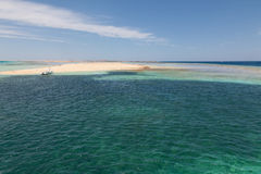 The island in the Red Sea. The yacht at the desert island in the Red Sea royalty free stock image