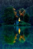 Island reflection at sunset. Reflected island on Lake Koenigssee, Germany Stock Photography