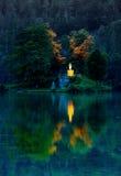 Island reflection at sunset Stock Photography