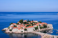The island resort of Sveti Stefan, Montenegro. In the sunlight, early morning Royalty Free Stock Images