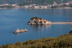 The island resort of Sveti Stefan, Montenegro. In the sunlight Stock Photography