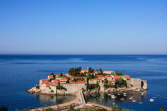 The island resort of Sveti Stefan, Montenegro. In the sunlight, early morning Stock Photos