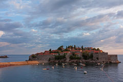 The island resort of Sveti Stefan, Montenegro. Cloudy sunset Royalty Free Stock Photography