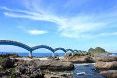 Island rock and beautiful bridge. Stock Images