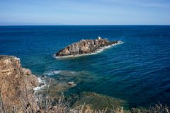 Island. Rock formation in the mediterranean sea Stock Photography