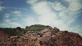 Island. Rocks and sky background Royalty Free Stock Photo