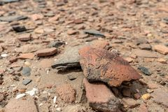 Floor scattered with thousends of pieces of scattered pottery on an archeological site on Sai Island in the Sudan royalty free stock images