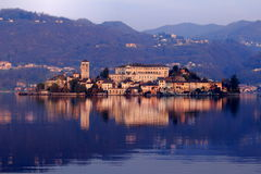 Island of San Giulio at down. Royalty Free Stock Photos