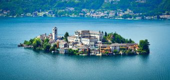 The island of San Giulio by the Italian lake - lago d`Orta, Piemonte, Italy. stock photos