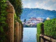 The island of San Giulio by the Italian lake - lago d`Orta, Piemonte, Italy. Stock Photos