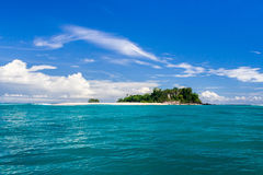 Island and sandbank Stock Images