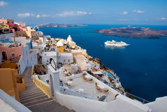 The island of Santorini. Morning view of the harbor, the volcano and Thira Royalty Free Stock Photos