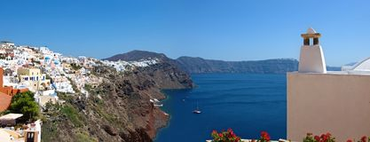 The island of Santorini. Panorama. With one of the terraces overlooking the coast of the island and the caldera. At the top is visible most of the city Royalty Free Stock Photos
