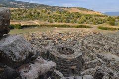 Island of Sardinia, Italy. Archaeological site Nuraghi of Barumini. Ruins archaeological landscape in Sardinia. Nuragic culture. Ancient stone circles and royalty free stock photos