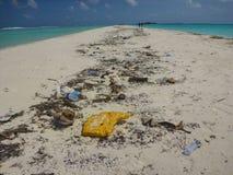 Island Scene with trash Royalty Free Stock Photos