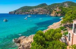 Island scenery, bay with boats at beautiful bay Majorca, Spain. Idyllic bay with boats at the coast of Camp de Mar on Mallorca island, Spain Mediterranean Sea Stock Image