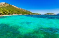 Island scenery, beautiful beach at coast of Platja de Formentor, Mallorca Spain. Idyllic view of seaside beach platja de Formentor on Majorca island, Spain Stock Image